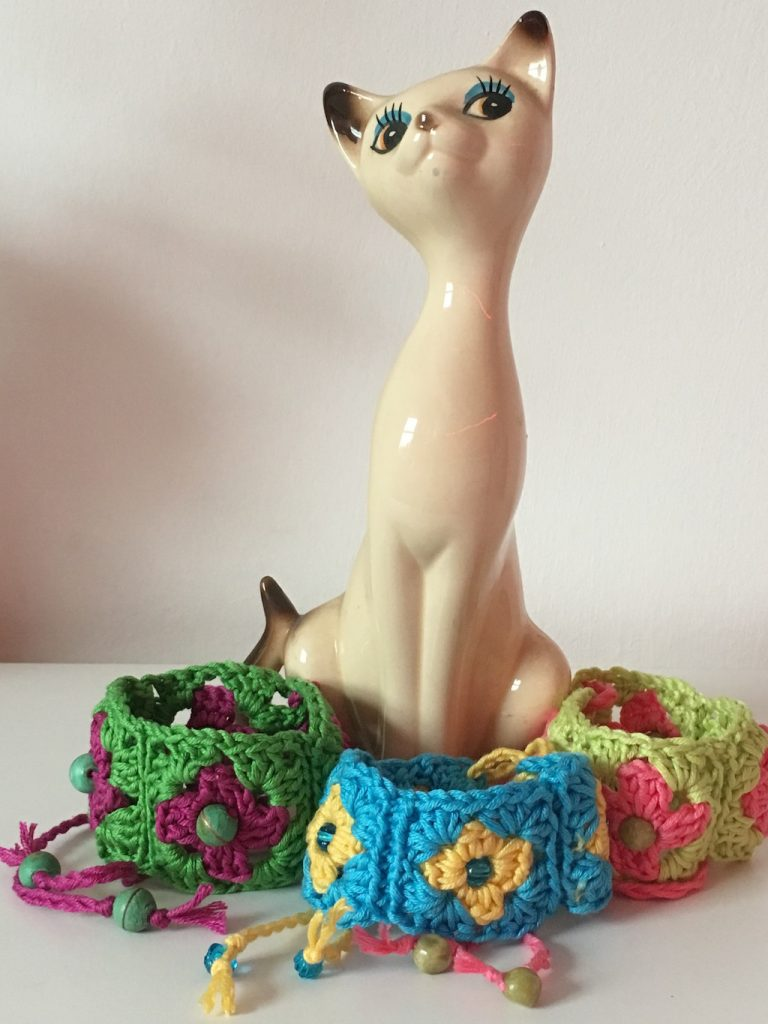 Cat ornament with three colourways of granny squares wristbands