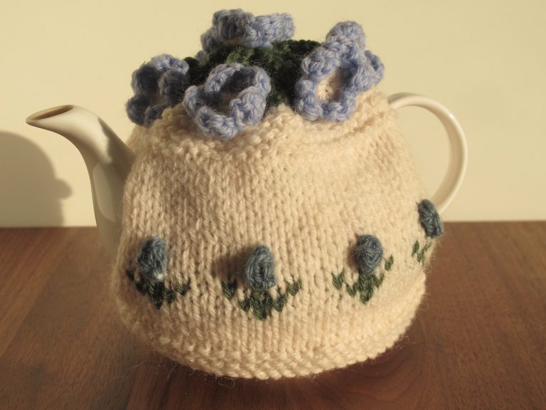 Cream tea cosy with little blue flowers