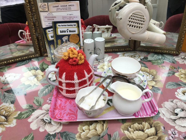Pickte fence tea cosy on teapot on tray on dressing table