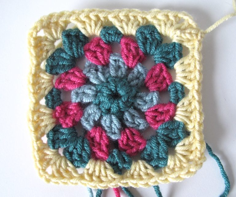 Fifth round of floral granny square