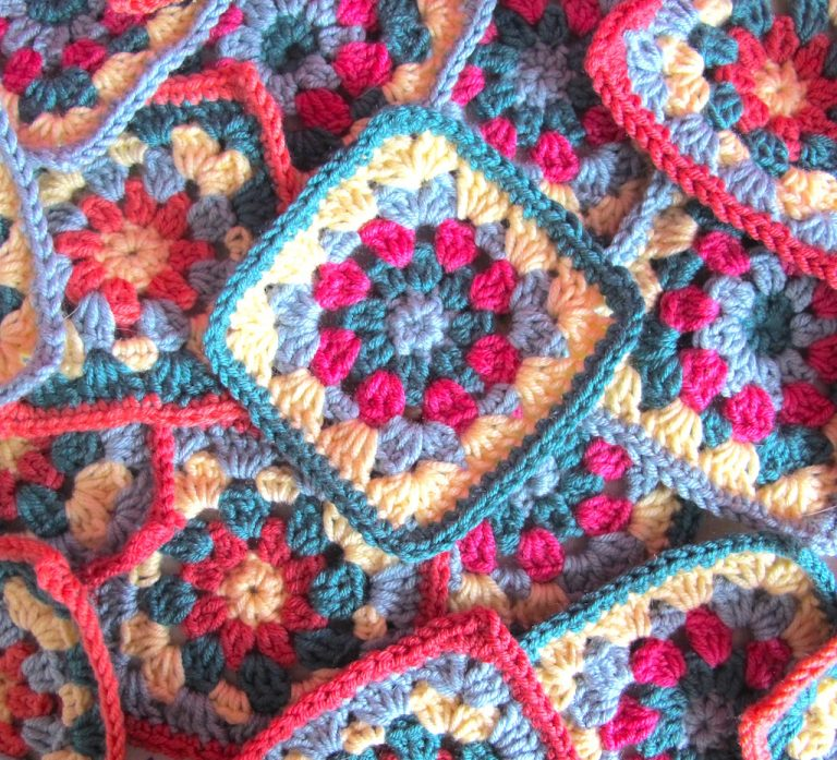 Pile of floral granny squares