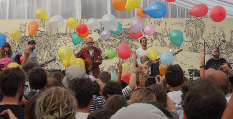 Diagrams playing at End of the Road Festival with balloons