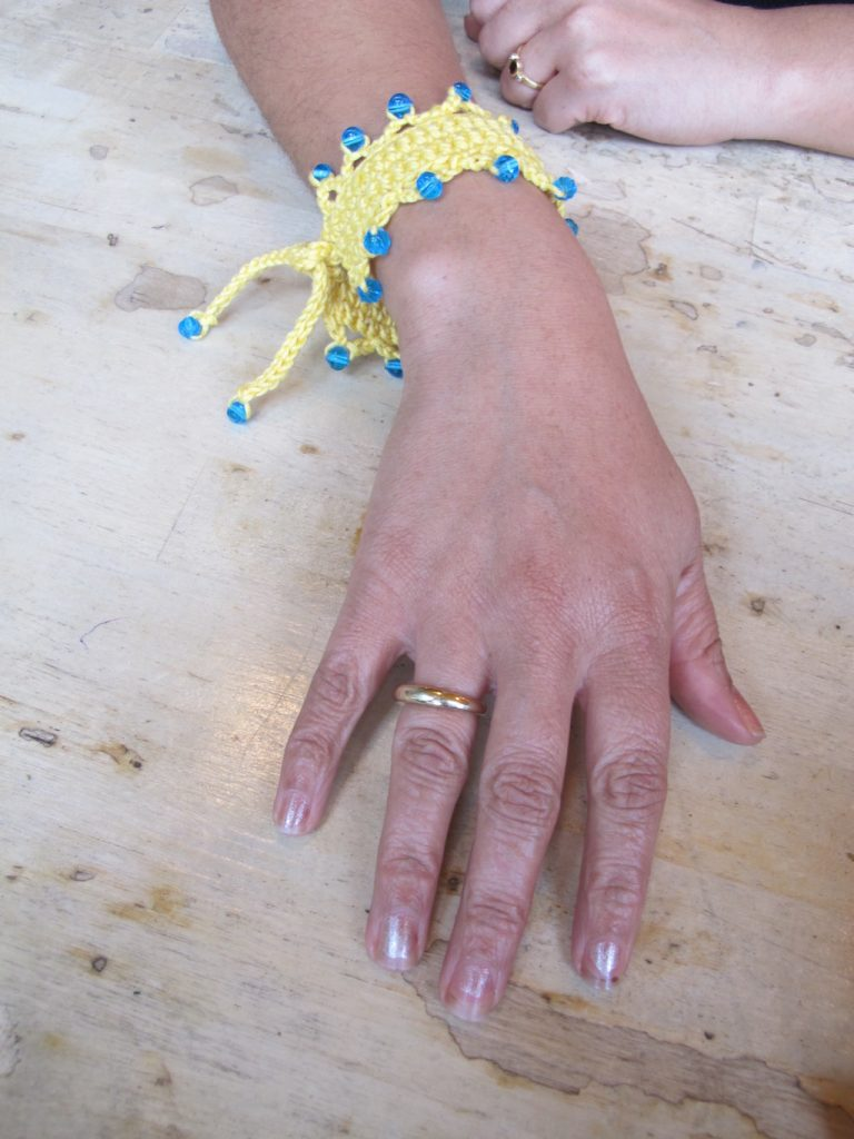 beaded yellow crochet wristband