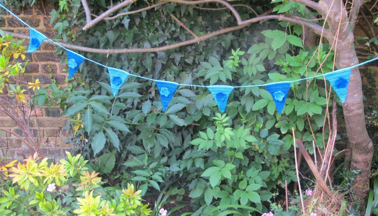 blue floral crochet bunting in tree