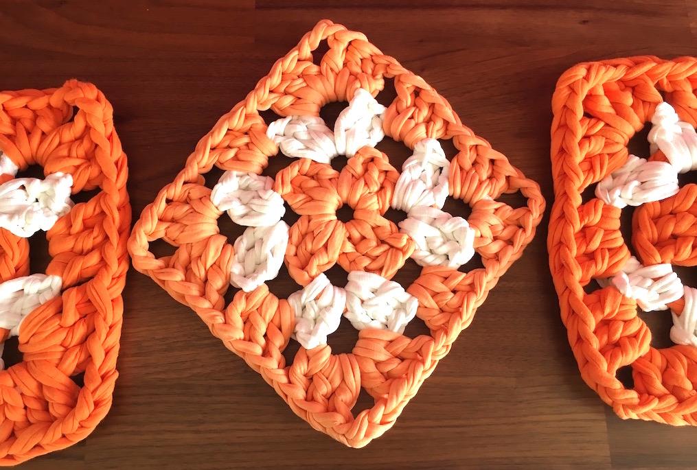 Three large orange and white granny squares