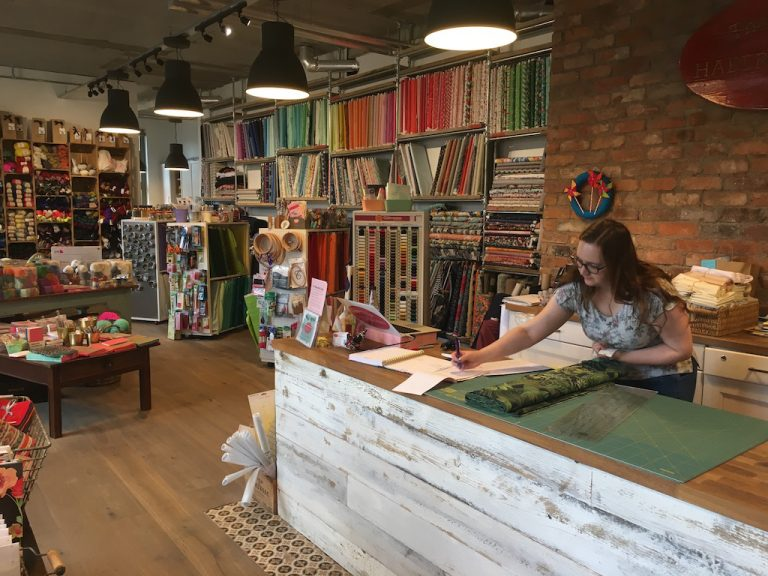 Inside The Village Haberdashery with lady at the counter
