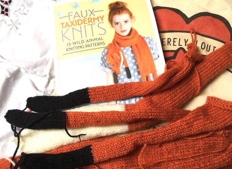 knitted fox legs and book containing fox stole pattern