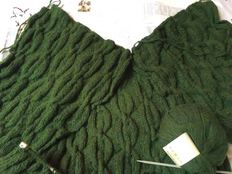 green cabled pieces of Glacier jumper