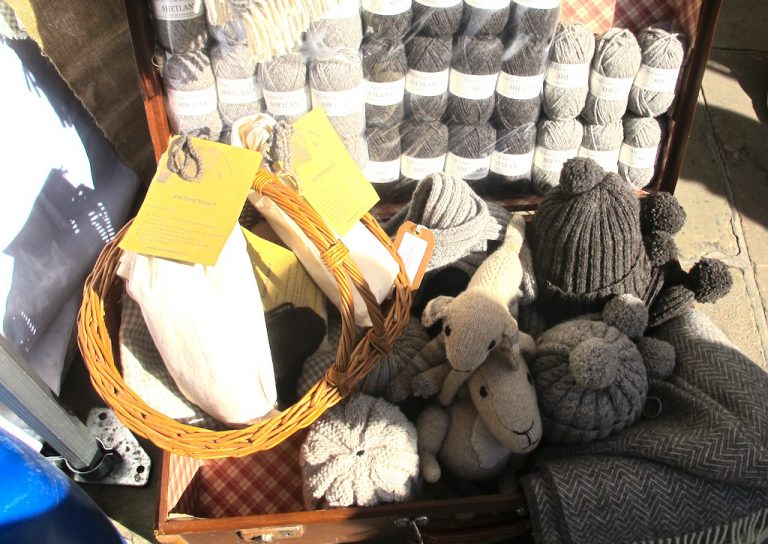 Ascog Wool's stall at the Wool Fair in London with knitted sheep
