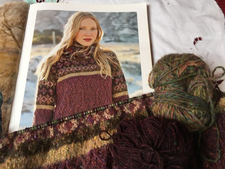 Part worked piece of Ness jumper with picture of finished garment