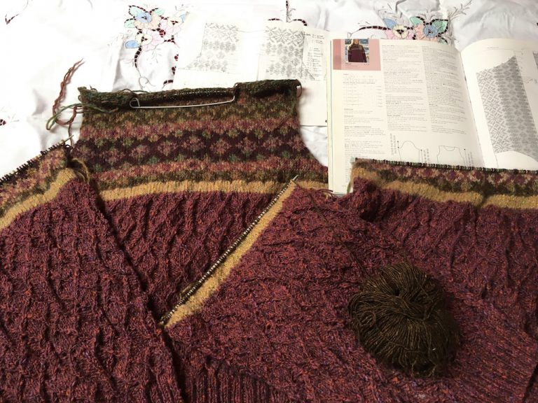 Part finished pieces of Ness jumper with pattern book
