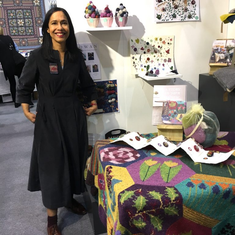 Dee Hardwicke with her throw and book on Rowan stand at Knitting & Stitching Show