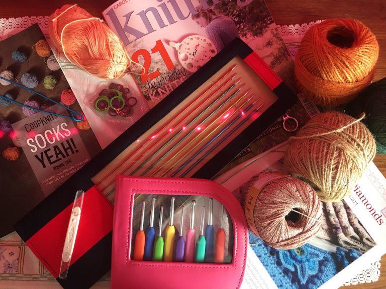 Crochet hooks, wool, twine, magazines and knitting needles