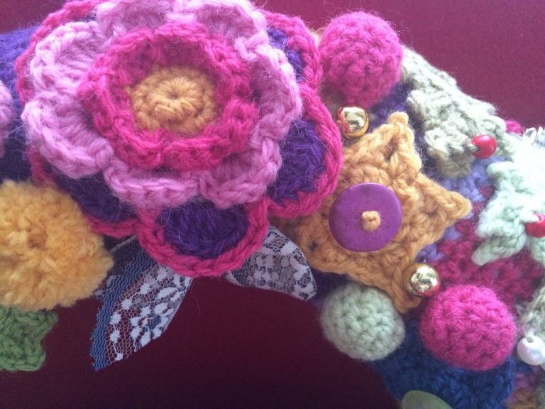 close up of Christmas crochet wreath
