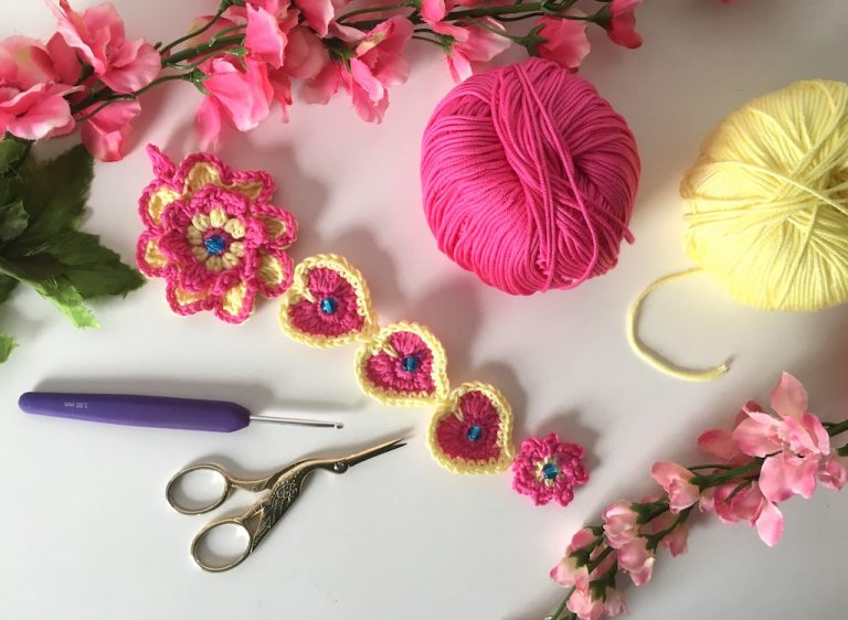 crochet hearts and flowers wall hanging in progress