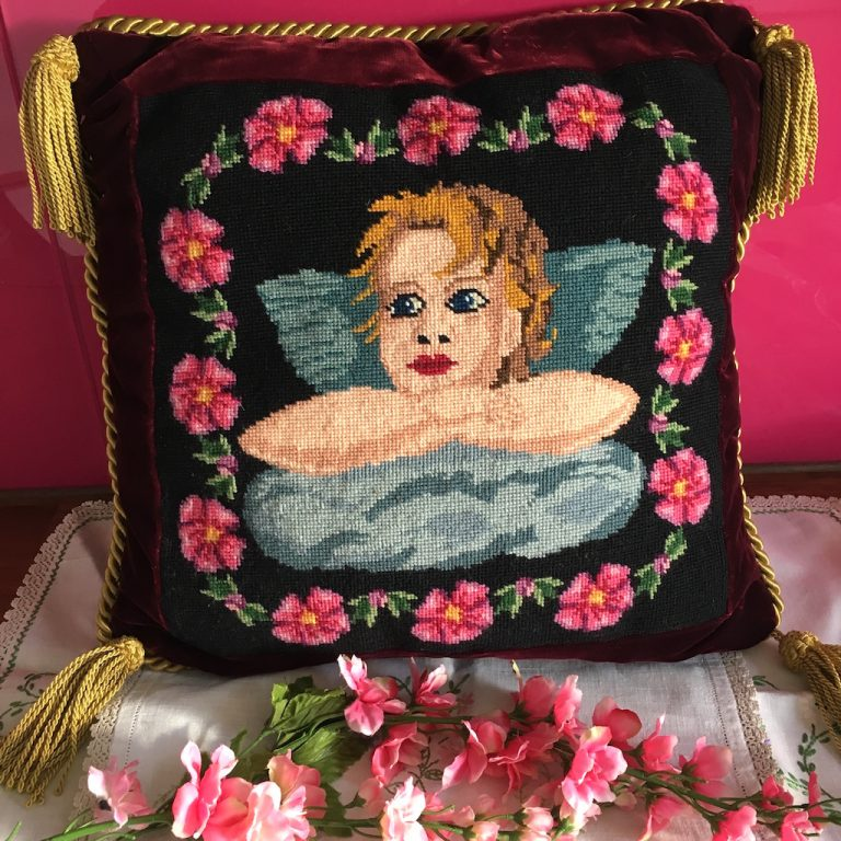 Tapestry cushion cover featuring cherub and flowers