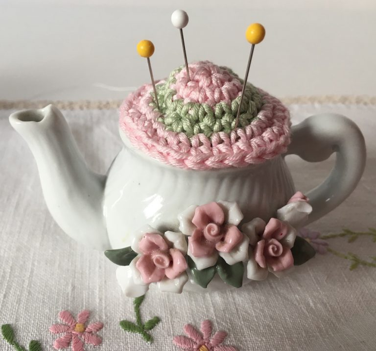 crochet pincushion in little china teapot decorated with roses