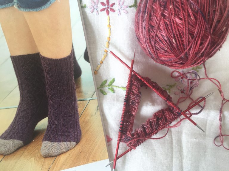 Socks being knitted and pattern