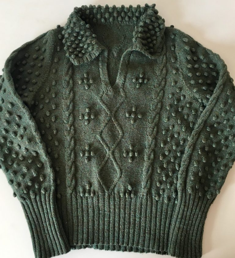 Green version of the bobble and cable sweater desinged by Patricia Hodge