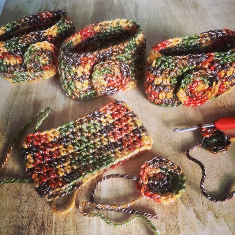 Mug cozies in autumn colours