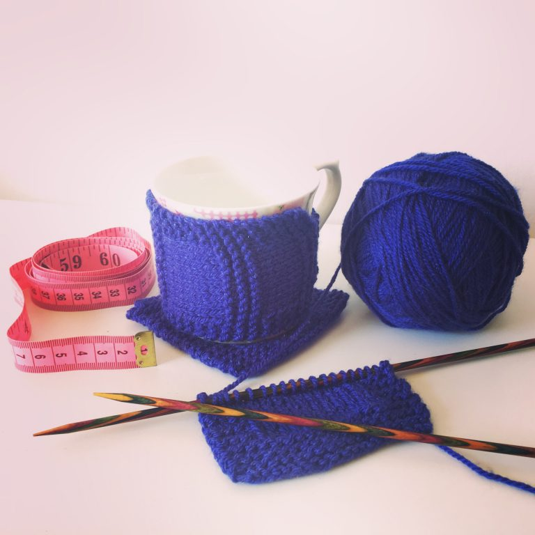 Mug cozy and matching knitted coaster