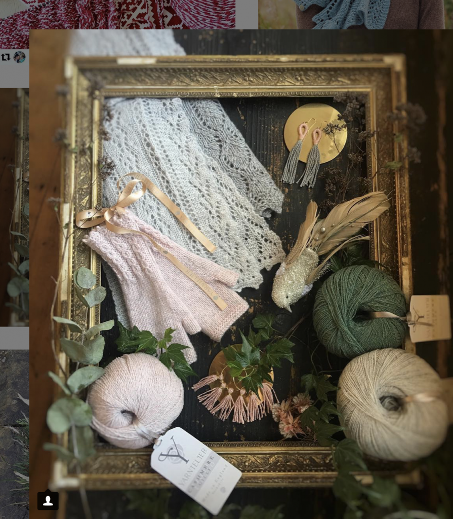 Yarntelier yarn and sample arranged within a gilt frame with natural accessories