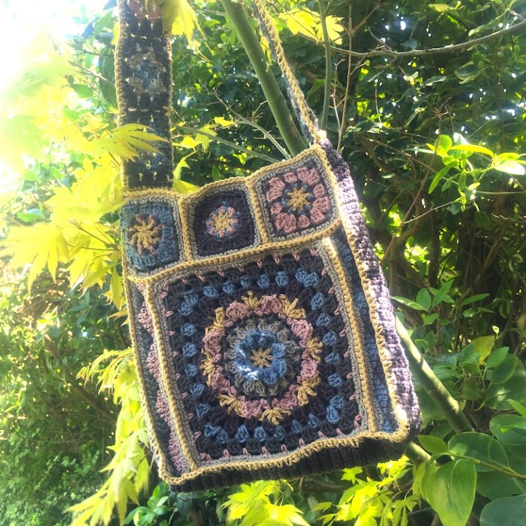 Granny Square bag hanging in a tree